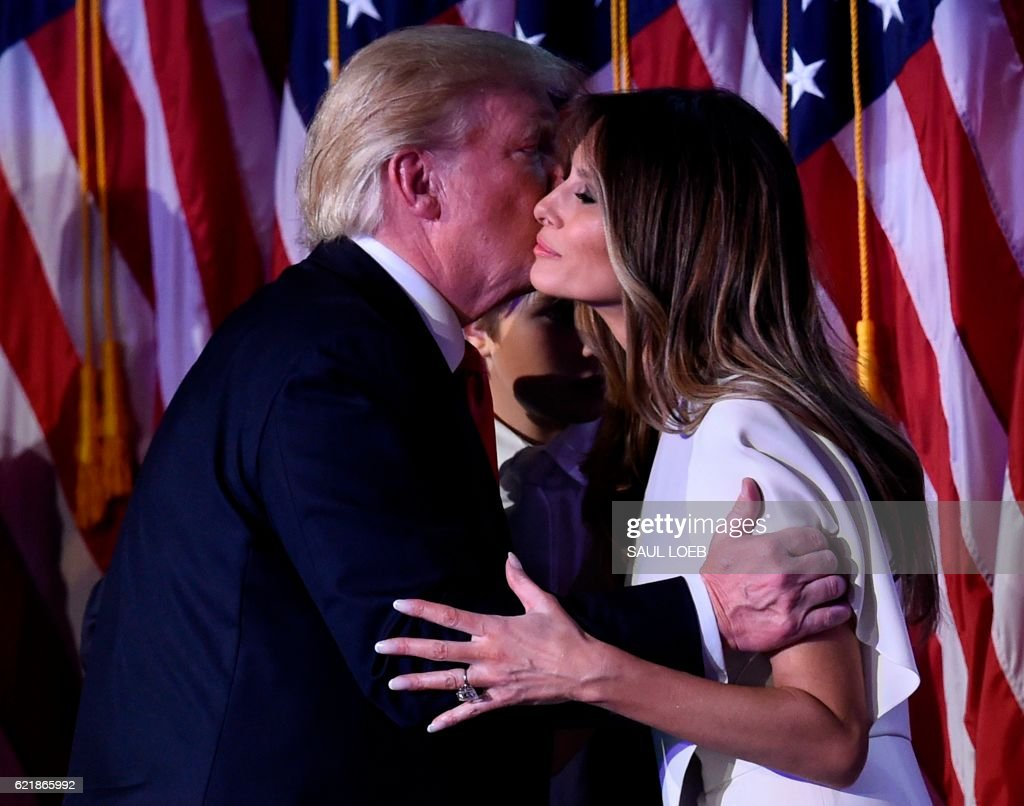President-elect Donald Trump greets wife Melania after speaking at the New York Hilton Midtown in New York on November 8, 2016. Trump stunned America and the world Wednesday, riding a wave of populist resentment to defeat Hillary Clinton in the race to become the 45th president of the United States. /
