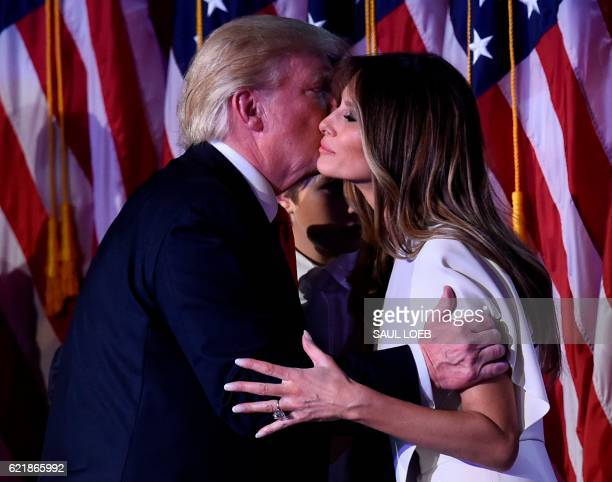 Presidentelect Donald Trump greets wife Melania after speaking at the New York Hilton Midtown in New York on November 8 2016 Trump stunned America...