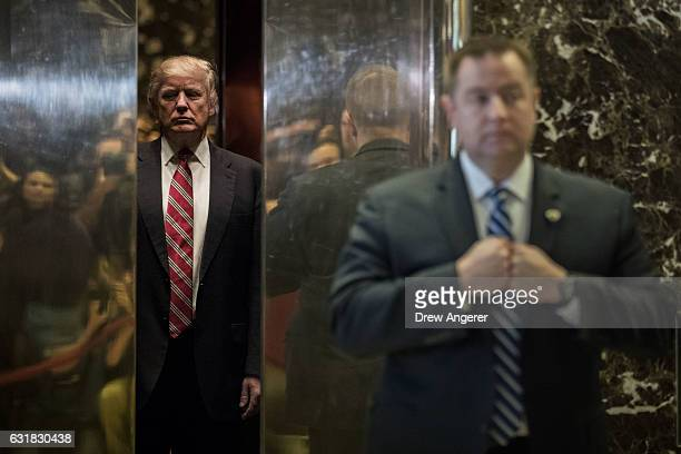 Presidentelect Donald Trump heads back into the elevator after shaking hands with Martin Luther King III after their meeting at Trump Tower January...