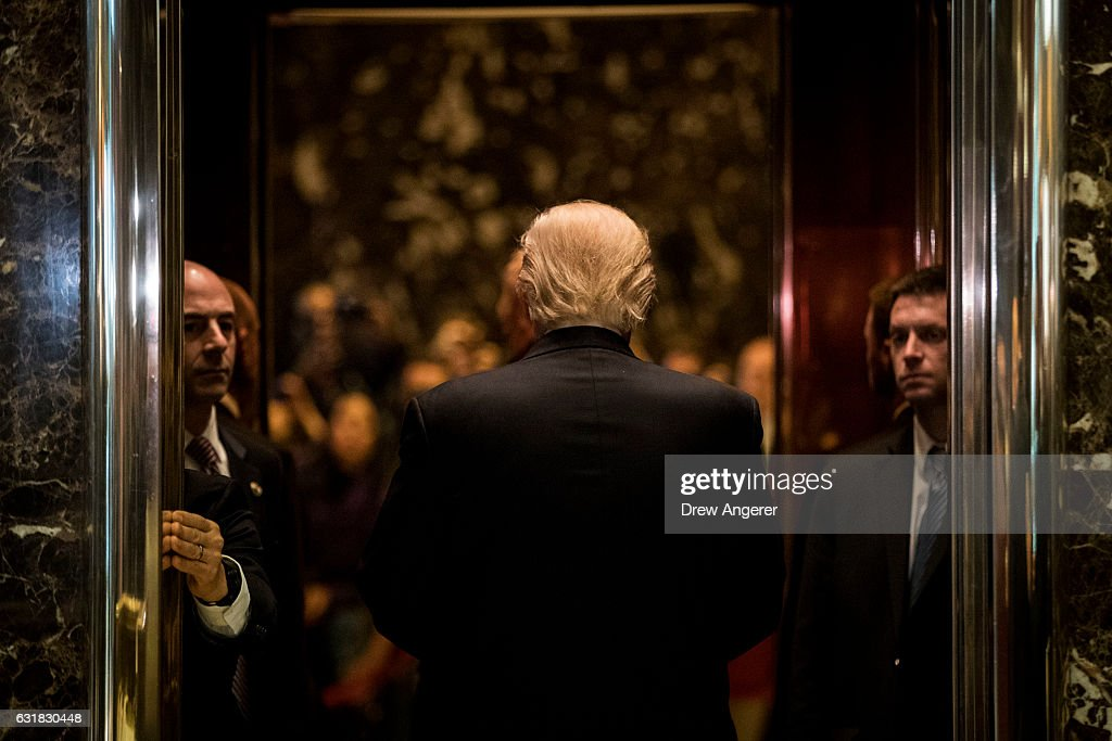 President-elect Donald Trump heads back into the elevator after shaking hands with Martin Luther King III after their meeting at Trump Tower, January 16, 2017 in New York City. Trump will be inaugurated as the next U.S. President this coming Friday.