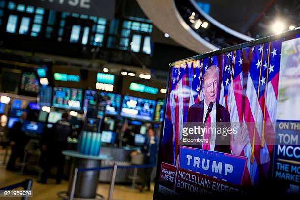 US Presidentelect Donald Trump is seen speaking on a television on the floor of the New York Stock Exchange in New York US on Wednesday Nov 9 2016 US...