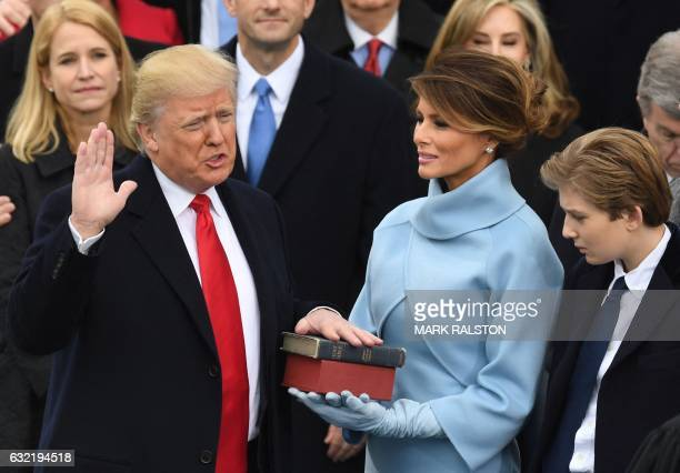 Presidentelect Donald Trump is sworn in as President on January 20 2017 at the US Capitol in Washington DC / AFP / Mark RALSTON