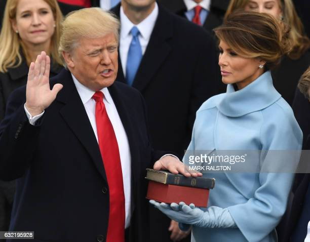 US Presidentelect Donald Trump is sworn in as President on January 20 2017 at the US Capitol in Washington DC / AFP PHOTO / Mark RALSTON