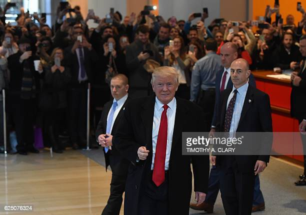 US Presidentelect Donald Trump leaves after a meeting at the New York Times on November 22 2016 in New York US Presidentelect Trump on Tuesday...