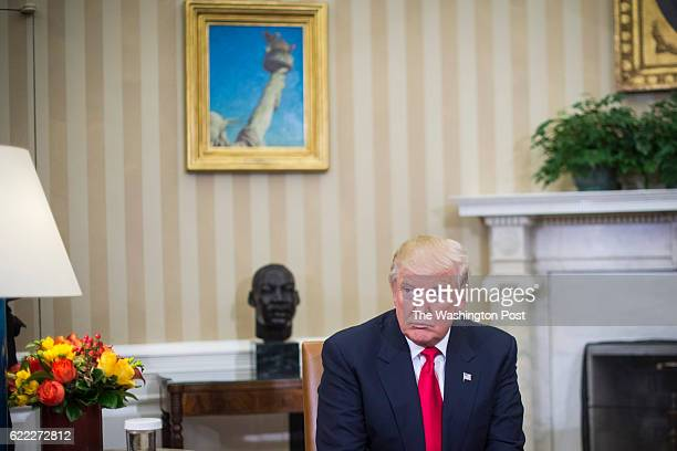 Presidentelect Donald Trump listens as President Barack Obama talks to the media in the Oval Office of the White House in Washington Thursday Nov 10...