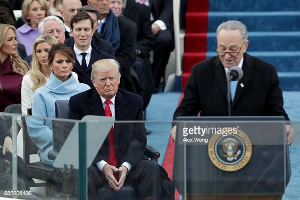 PresidentElect Donald Trump listens as Sen Charles Schumer speaks on the West Front of the US Capitol on January 20 2017 in Washington DC In today's...