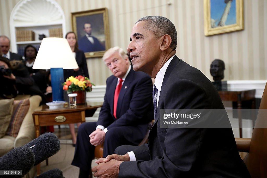 President-elect Donald Trump (L) listens as U.S. President Barack Obama speaks during a meeting in the Oval Office November 10, 2016 in Washington, DC. Trump is scheduled to meet with members of the Republican leadership in Congress later today on Capitol Hill.