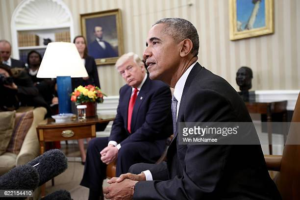 Presidentelect Donald Trump listens as US President Barack Obama speaks during a meeting in the Oval Office November 10 2016 in Washington DC Trump...