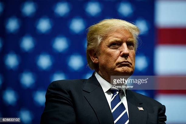 President-elect Donald Trump looks on during a rally at the DeltaPlex Arena, December 9, 2016 in Grand Rapids, Michigan. President-elect Donald Trump...