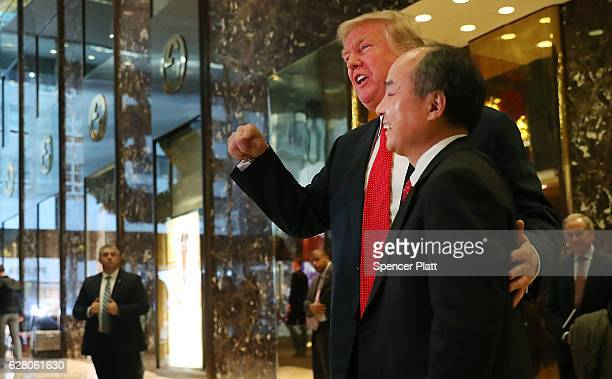 Presidentelect Donald Trump pauses with Masayoshi Son the chief executive of SoftBank at Trump Tower on December 6 2016 in New York City Trump...