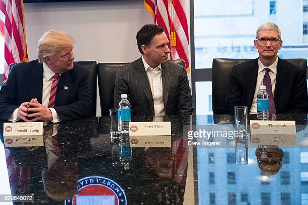 Presidentelect Donald Trump Peter Thiel and Tim Cook chief executive officer of Apple Inc listen during a meeting with technology executives at Trump...