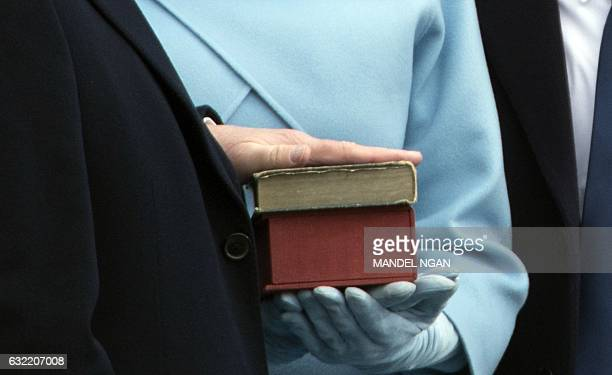 Presidentelect Donald Trump places his hand on a bible as he takes the oath of office as the next president of the United States on January 20 2017...