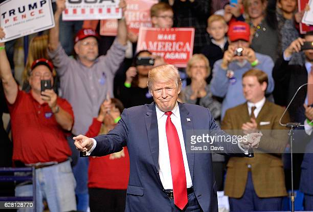 Presidentelect Donald Trump points to his supporters during his 'Thank You' rally at Crown Coliseum on December 6 2016 in Fayetteville North Carolina...