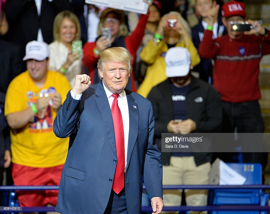 President-elect Donald Trump pumps his fist to cheers at Crown Coliseum on December 6, 2016 in Fayetteville, North Carolina. Trump took time off from selecting the cabinet for his incoming administration to celebrate his victory in the general election.