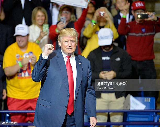 President-elect Donald Trump pumps his fist to cheers at Crown Coliseum on December 6, 2016 in Fayetteville, North Carolina. Trump took time off from...