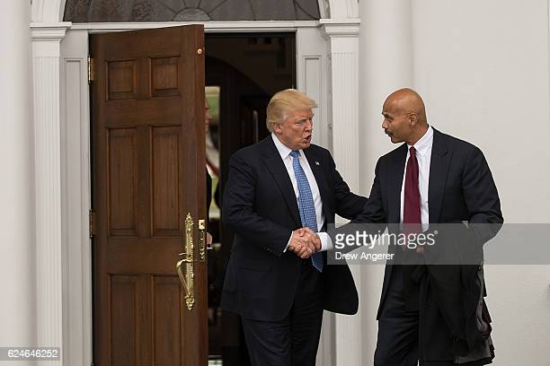 Presidentelect Donald Trump shakes hands with Peter Kirsanow attorney and member of the US Commission on Civil Rights after their meeting at Trump...