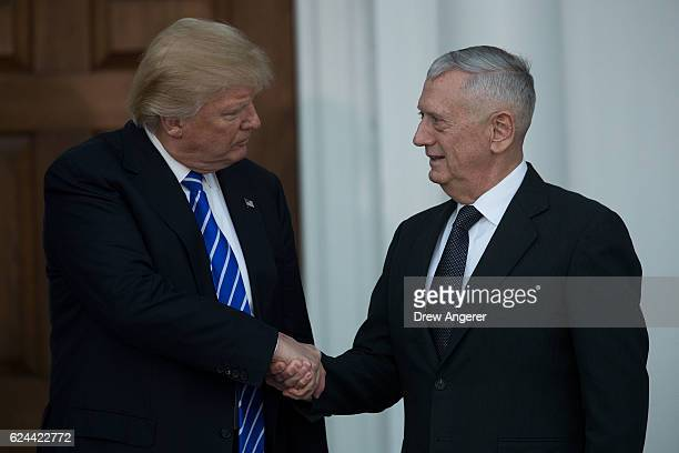 Presidentelect Donald Trump shakes hands with retired United States Marine Corps general James Mattis after their meeting at Trump International Golf...