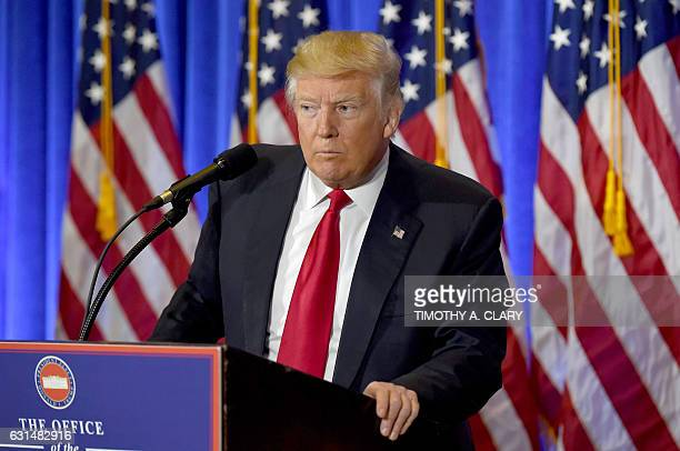 US Presidentelect Donald Trump speaks during a press conference January 11 2017 at Trump Tower in New York Trump held his first news conference in...