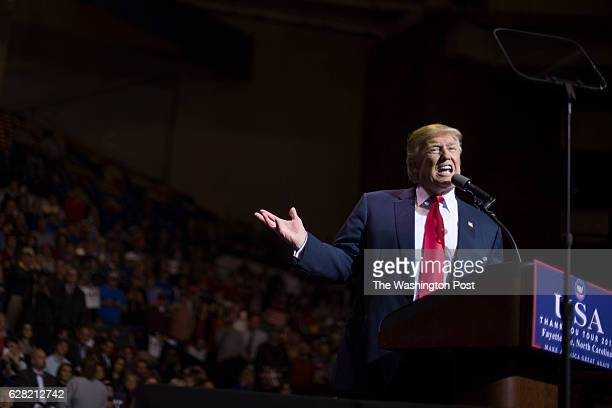 """President-elect Donald Trump speaks during a """"USA Thank You Tour 2016"""" event in the Crown Coliseum in Fayetteville, NC on Tuesday, Dec. 06, 2016."""