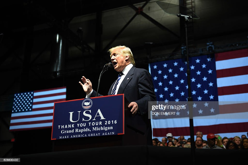 US President-elect Donald Trump speaks during the USA Thank You Tour December 9, 2016 in Grand Rapids, Michigan. / AFP / DON