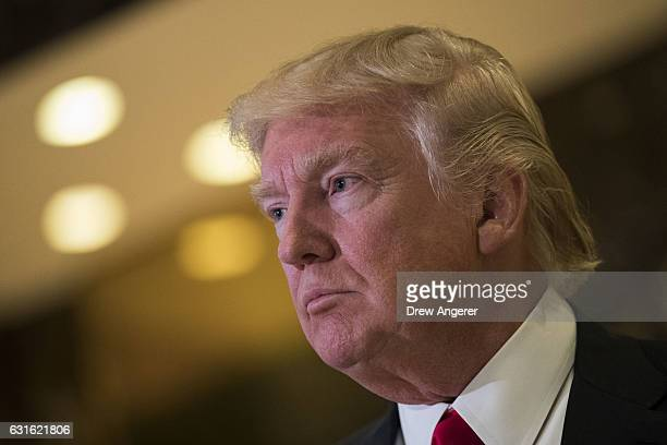 Presidentelect Donald Trump speaks to reporters after his meeting with television personality Steve Harvey at Trump Tower January 13 2017 in New York...