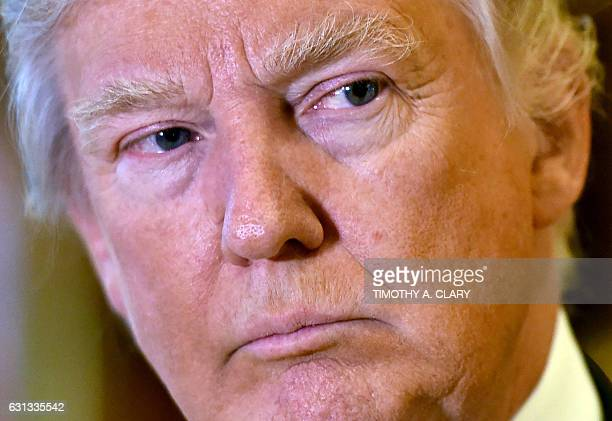 Presidentelect Donald Trump speaks to the media at Trump Tower January 9 2017 in New York / AFP / TIMOTHY A CLARY