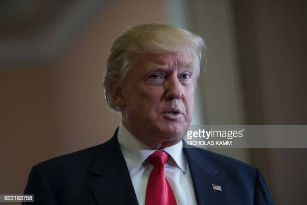 US Presidentelect Donald Trump speaks to the press following a meeting with Senate Majority Leader Mitch McConnell at the Capitol in Washington DC on...