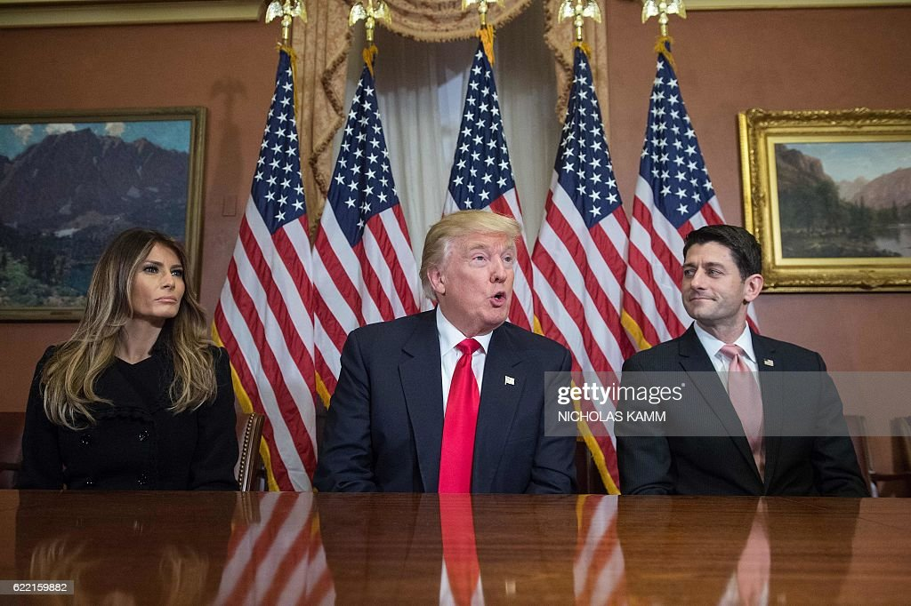 US President-elect Donald Trump speaks to the press with his wife Melania and House Speaker Paul Ryan at the US Capitol in Washington, DC, on November 10, 2016. / AFP / NICHOLAS