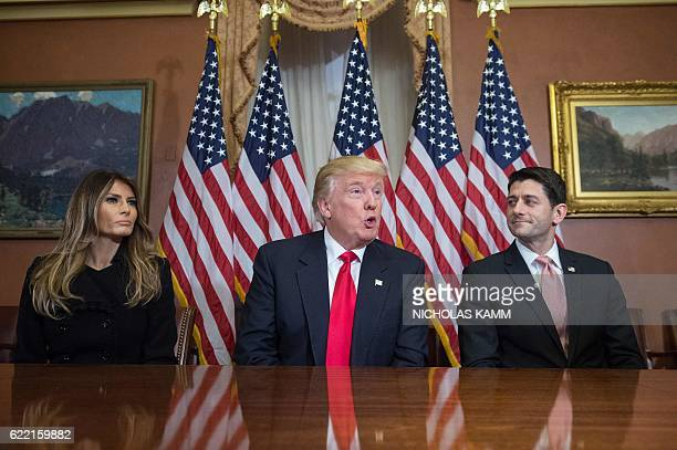 US Presidentelect Donald Trump speaks to the press with his wife Melania and House Speaker Paul Ryan at the US Capitol in Washington DC on November...