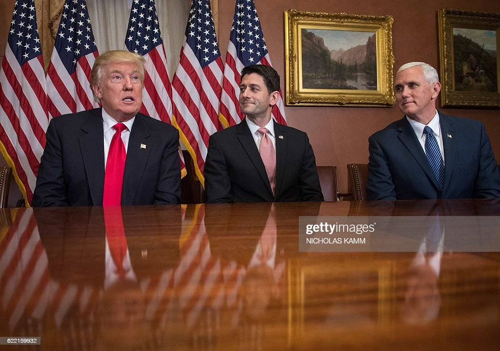 US President-elect Donald Trump speaks to the press with House Speaker Paul Ryan and Vice President-elect Mike Pence at the US Capitol in Washington, DC, on November 10, 2016. / AFP / NICHOLAS