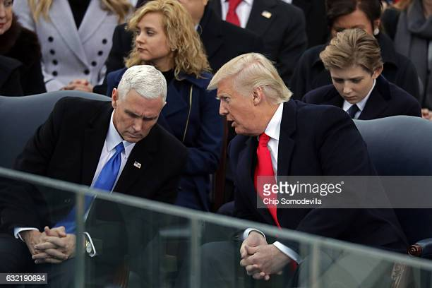 S Presidentelect Donald Trump speaks to Vice Presidentelect Mike Pence on the West Front of the US Capitol on January 20 2017 in Washington DC In...