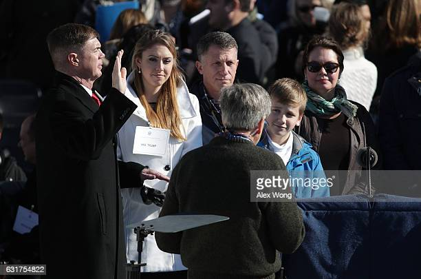 PresidentElect Donald Trump standin Army SGT MAJ Greg Lowery and Melania Trump standin Army SPC Sara Corry take part in the dress rehearsal for the...