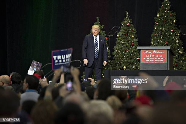 President-elect Donald Trump stands on stage during an event in West Allis, Wisconsin, U.S., on Tuesday, Dec. 13, 2016. The president elect said...