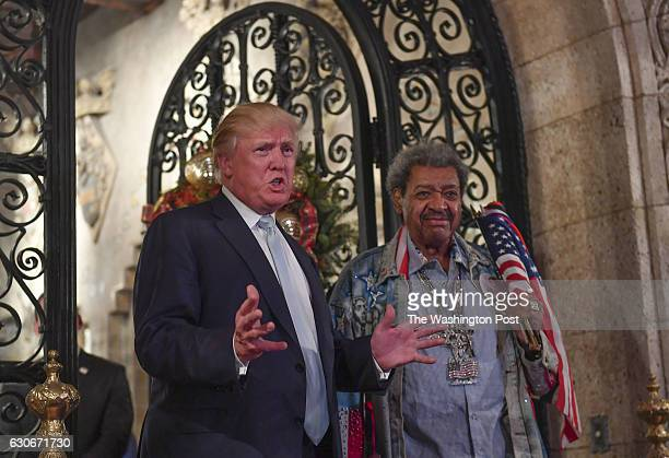 President-elect Donald Trump stands with legendary fight promoter Don King as they address the media during a party at Mar-a-Lago Club on December...