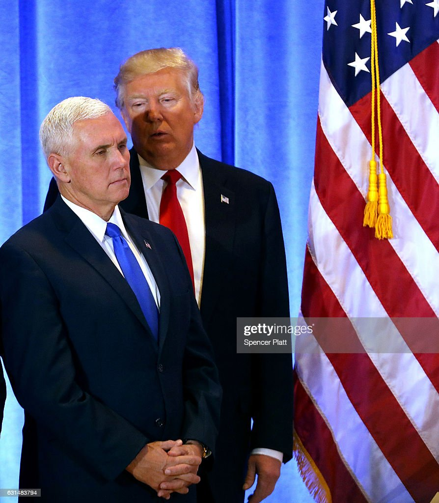 President-elect Donald Trump stands with Vice President-elect Mike Pence at a news conference at Trump Tower on January 11, 2017 in New York City. This is Trump's first official news conference since the November elections.