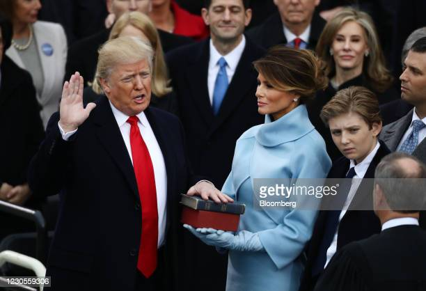 President-elect Donald Trump takes the oath of office as First Lady-elect Melania Trump, looks on during the 58th presidential inauguration in...