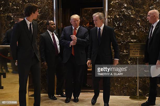 Presidentelect Donald Trump talks with Alexandre Arnault Bernard Arnault Chairman and CEO of LVMH Moët Hennessy Louis Vuitton after their meeting at...