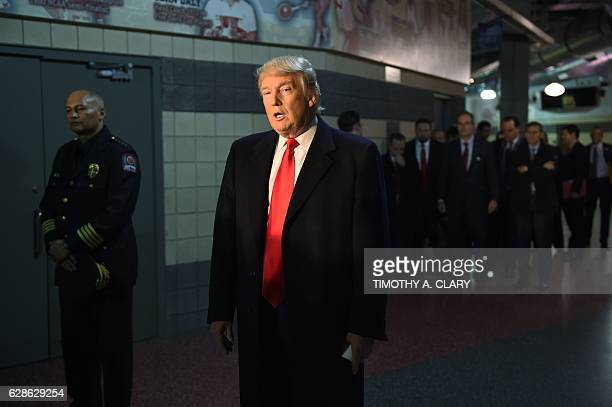 Presidentelect Donald Trump talks with media after his meeting with families and victims of last week's attack at Ohio State University December 8...