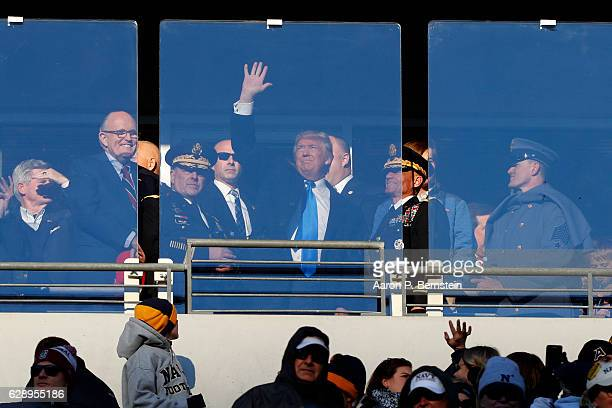 Presidentelect Donald Trump watches the game between the Navy Midshipmen and the Army Black Nights at MT Bank Stadium on December 10 2016 in...