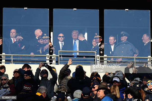 Presidentelect Donald Trump waves to the crowd while attending the Army Black Knights and Navy Midshipmen game at MT Bank Stadium on December 10 2016...