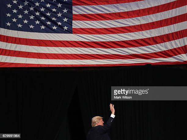 Presidentelect Donald Trump waves to the crowd while being introduced to speak to supporters at the Giant Center December 15 2016 in Hershey...