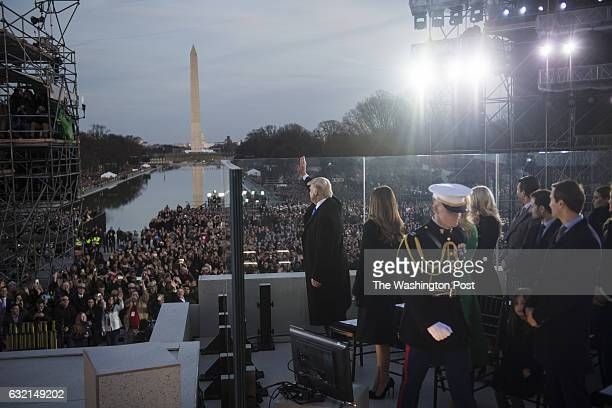 Presidentelect Donald Trump waves with his family members to the crowd at the Lincoln Memorial during a Make America Great Again thank you concert in...