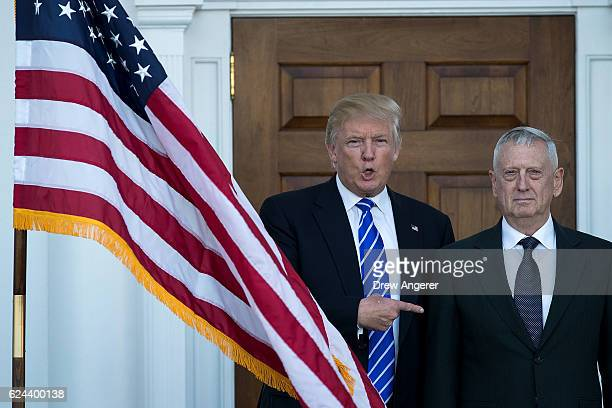 Presidentelect Donald Trump welcomes retired United States Marine Corps general James Mattis as they pose for a photo before their meeting at Trump...