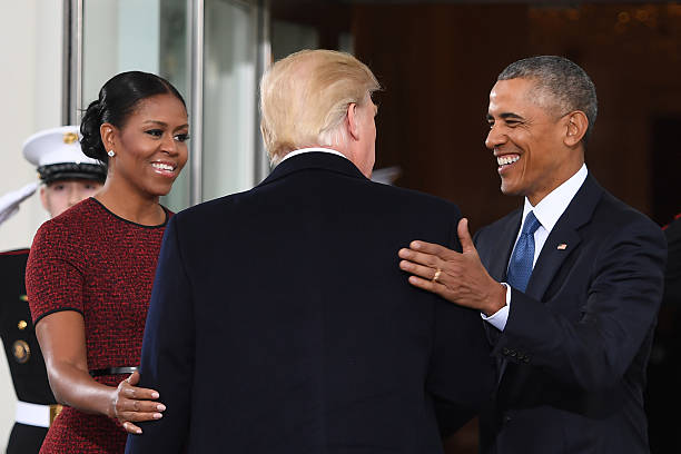 Donald and melania trump arrive at white house ahead of inauguration topshot president elect donald trumpcis greeted by us president barack m4hsunfo