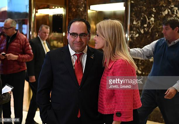 US Presidentelect Donald Trump's campaign manager Kellyanne Conway talks with George Gigicos at the Trump Tower lobby in New York on November 17 2016...