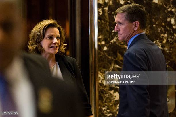 Presidentelect Donald Trump's National Security Advisors KT McFarland and Michael Flynn are seen at Trump Tower in New York on December 5 2016 / AFP...