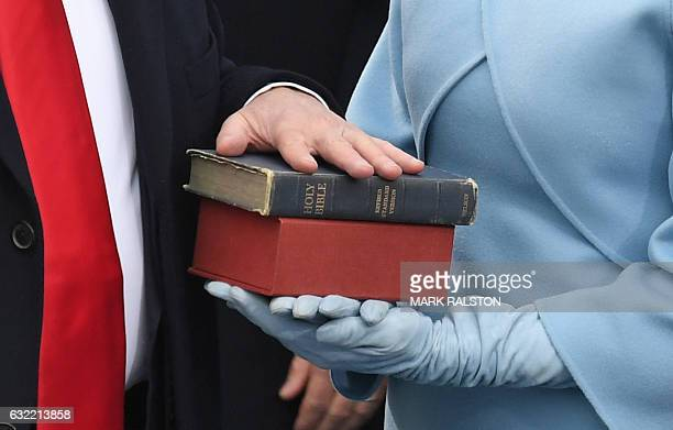 US Presidentelect Donald Trump's wife holds a Bible as Trump is sworn in as President on January 20 2017 at the US Capitol in Washington DC / AFP /...