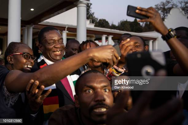 President-elect Emmerson Mnangagwa steps onto the lawn to pose for photographs and selfies after attending a press conference on August 3, 2018 in...