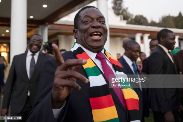 President-elect Emmerson Mnangagwa steps onto the lawn to pose for photographs after attending a press conference on August 3, 2018 in Harare,...