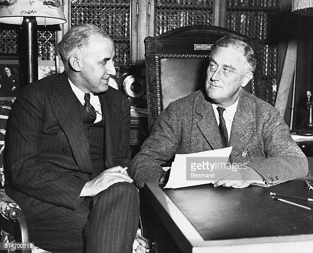 Presidentelect Franklin Roosevelt talks with Raymond Moley before his inauguration Moley would be named Assistant Secretary of State but his primary...